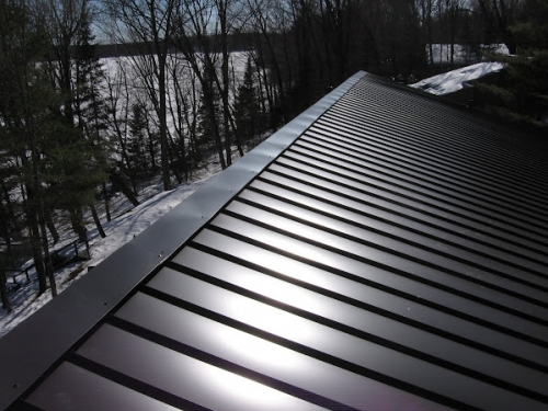 Captivating Standing Seam Metal Roofing Installed During The Winter